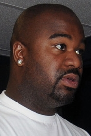 Albert Haynesworth gets ready to eat someone, throw hundos in the air and demand more trades. From Wikipedia.