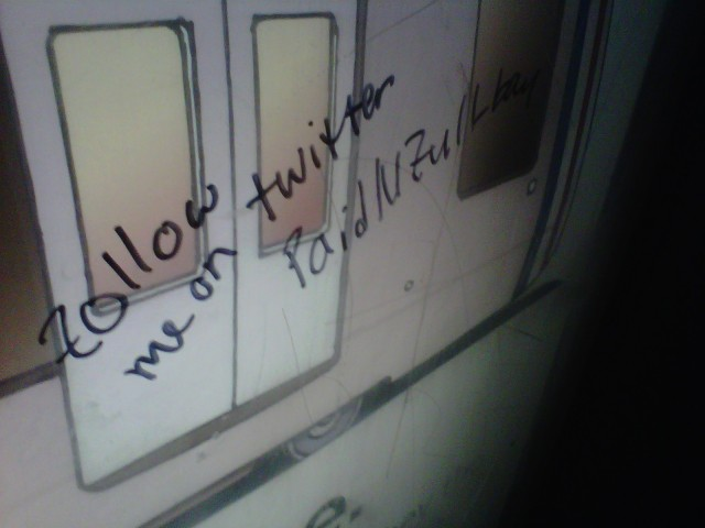 Twitter graffiti in Stadium-Armory Station.
