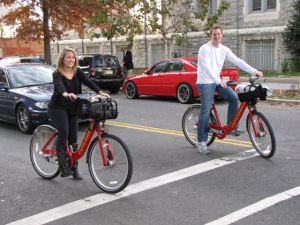 Wild guess: The dude in the flossed-out whip is less enthused than the cheesing bike riders. From Wikipedia.
