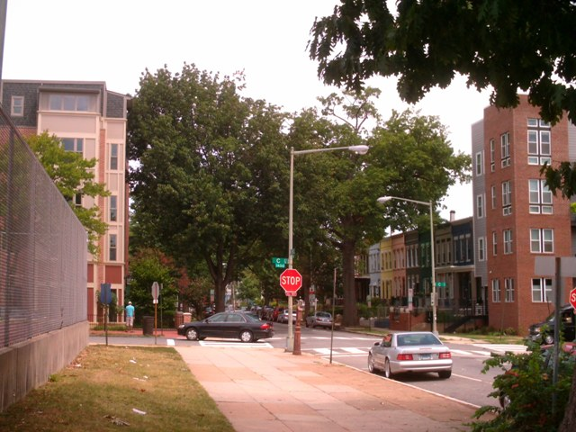 Looking north at 15th and C SE, where a trio of mid-rise buildings give the block a big-city feel.
